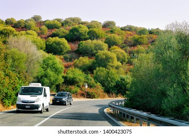 Porto Cervo, Italy - September 9, 2017: Rv cavaran and car on the road in Costa Smeralda on Sardinia Island in Italy in summer. Motorhome rving on motorway. Camper trailer on highway.