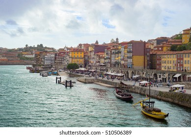 Porto city Douro river embankment ribeira historic town panorama romantic promenade market boats