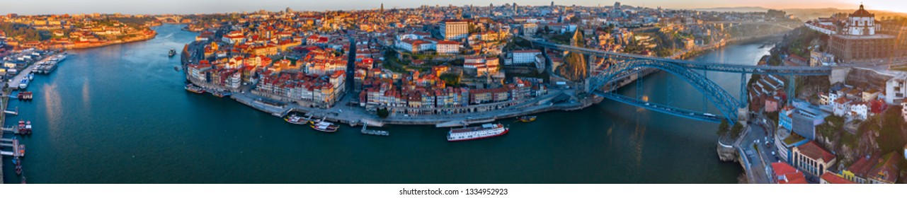 Porto Cityscape with Dom Luis I Bridge over Douro River and medieval Ribeira district, Portugal. One of the oldest European centres, its historical core was proclaimed a World Heritage Site by UNESCO.