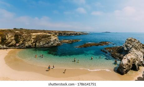 Porto Covo, Portugal - July 18, 2020: Praia dos Buizinhos beach, in Porto Covo, Alentejo, Portugal famous for its small sand area and cliffs surrounding