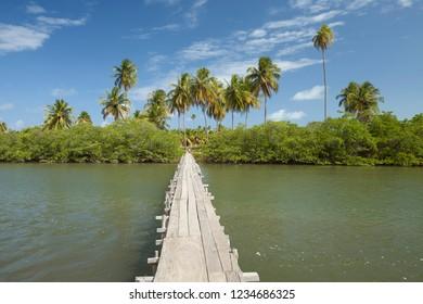 Porto de Pedras, Alagoas / Brazil - 09/13/2015: Wood bridge over Tatuamunha River, Tatuamunha District