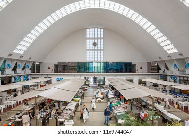 Porto,  District of Porto, Portugal - June 15 2018 : View looking down from the first floor balcony on the bright and airy Mercado dos Matosinhos indoor fish market, with the curved roof windows