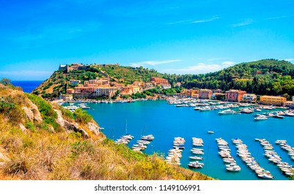 Porto Ercole town,  Monte Argentario, in the Province of Grosseto, Tuscany, Italy. Boats in harbor in a sea bay.