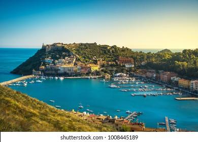 Porto Ercole village and boats in harbor in a sea bay. Aerial view. Monte Argentario, Maremma Grosseto Tuscany, Italy
