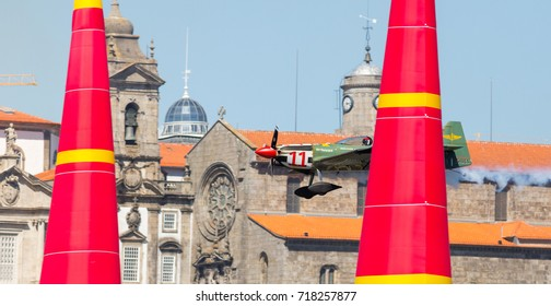 Porto & Gaia, Portugal - September 3, 2017: Red Bull Air Race, Raicing Day, Pilot: Mikael Brageot from France Breitling Racing Team.