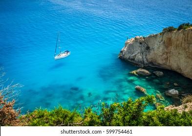 Porto Katsiki beach in Lefkada island, Greece. Luxury yacht on a blue sea.