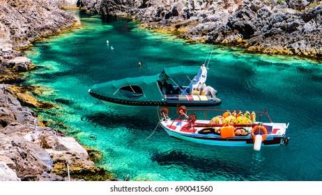 Porto Limnionas beach on Zakynthos island, Greece. Fishing boats.