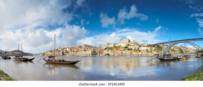 Porto old town cityscape on the Douro River with traditional Rabelo boats. Portugal
