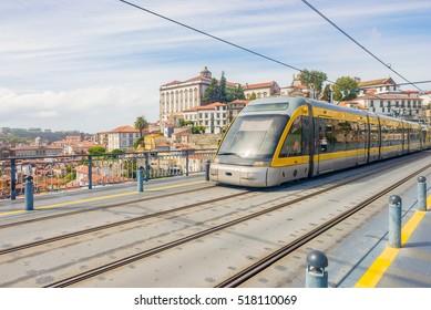 Porto Oporto metro subway tram rain train railway rail at bridge over Douro river, public transport illustration nobody