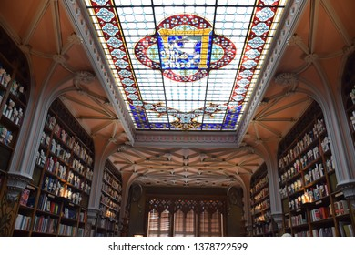 """Porto, Portugal 04.20.2019 the ceiling of the bookshop called """"livraria lello"""" famous from the Harry Potter story"""