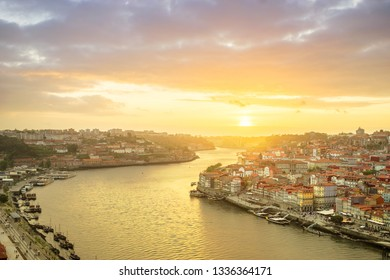 Porto, Portugal 05 13 2018 old town ribeira aerial promenade view with colorful houses, Douro river and boats at sunset