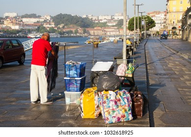 PORTO, PORTUGAL - 1 September: Porto is the second-largest city in Portugal after Lisbon. Saler on shopping street by river Douro in Porto on 1 September 2016, Portugal.