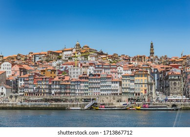 Porto, Portugal - 17/07/2019: Front view of the Ribeira, Colorful Houses.