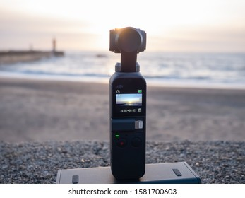 Porto, Portugal- 18.11.2019 Video making with gimbal Dji osmo pocket with ocean and sunset in the background.