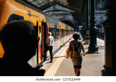 Porto, Portugal - 27 september, 2018: People enter into train in trainstation on summer day, Portugal