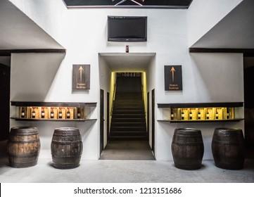 Porto, Portugal , 9th of July , 2018. Wine house interior. Tasting of port wine .Barrels in the wine cellar in Porto in Portugal