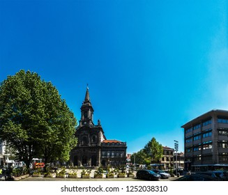 PORTO, PORTUGAL - APRIL 12 2017: Church of Trinity is church in Oporto in Portugal, located in Praca da Trindade behind building of City Hall of Porto. It was built of architect Carlos Amarante.