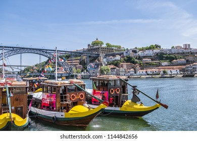"PORTO, PORTUGAL - APRIL 16, 2017: Most enthusiastic way to explore Douro Valley is by boat. Tourist boat ""Porto Cruz"" moored on the Ribeira Embankment of Douro River."