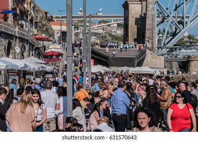 PORTO, PORTUGAL - APRIL 16, 2017: The promenad and the embankment of Duora river Ribeira - famous touristic district in Porto.