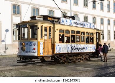 Porto, Portugal - April 18, 2018: Historical street tram in Porto waiting for passengers.