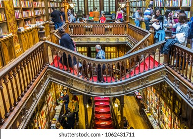 PORTO, PORTUGAL - APRIL 19, 2017: Inside the famous bookshop Lello e Irmao (1906), considered as one of the most beautiful bookstores in the world.