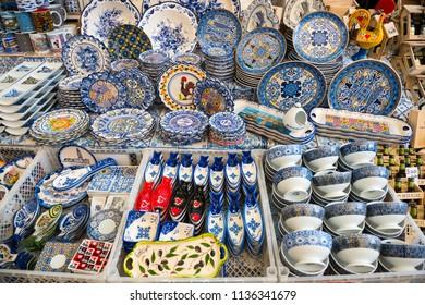 Porto, Portugal - April 20, 2018: Traditional portuguese souvenirs for sale at famous Porto market (Mercado do Bolhao).