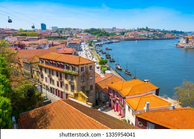 Porto, Portugal - April 20, 2018: Old City of Porto on Douro River at sunny day.
