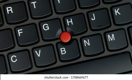 Porto, Portugal - April 20 2020: ThinkPad X260 laptop, close up of trackpoint and keyboard. Top down, overhead shot.