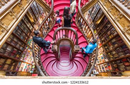 Porto, Portugal - April 2018: famous crimson stairs of the famous Lello bookshop