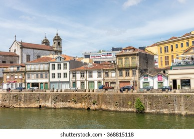 PORTO, PORTUGAL, APRIL 26, 2014: View of facades, alleyway and traditional houses in Ribeira old and historic town and alongside Douro River, Porto, Portugal