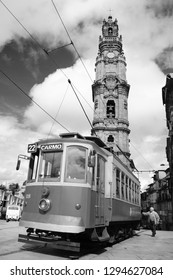 PORTO, PORTUGAL - APRIL 26, 2015: Senior man getting on the old tram near the Clerigos Tower, one of the famous landmarks and symbols of the city. Black and white photo.