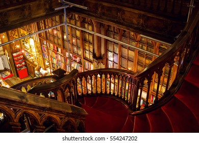 PORTO PORTUGAL - APRIL 28, 2016: Staircase at the Lello and Irmao bookstore, one of the oldest and most beautiful bookstore in the world