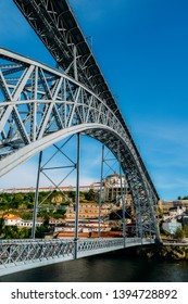 Porto, Portugal - April 29, 2019: Pedestrians on the Dom Luis I Bridge, a metal arch bridge that spans the Douro River between the cities of Porto and Vila Nova de Gaia, Portugal