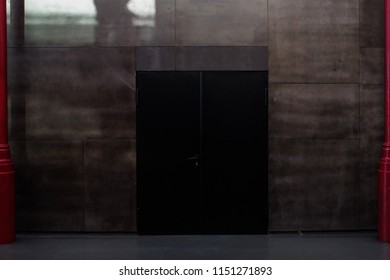 Porto, Portugal - April 4, 2017: Black door with red colums on both sides inside Mercado Ferreira Borges