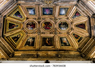 Porto, Portugal, August 14, 2017: Ceiling of one of the interior room of the Porto's Cathedral, richly decorated with oil paintings and carved wood.