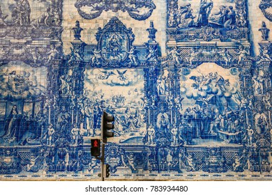 Porto, Portugal, August 14, 2017: Exterior walls of the Porto's Chapel of Souls are virtually entirely covered with blue and white ceramic tiles, depicting the Martyrdom of Santa Catarina.