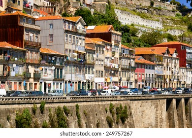 PORTO, PORTUGAL - AUGUST 16, 2014: Colorful facades of old houses on embankment of the Douro River  in Porto, Portugal. Porto is one of the most popular tourist destinations in Europe.