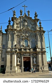Porto, Portugal - August 18, 2015: Beautiful facade of the twin churches Igreja do Carmo and Igreja dos Carmelitas. On the side is a panel of azulejos inaugurated in 1922.