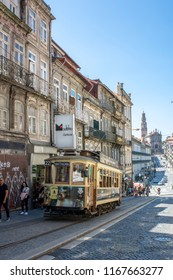 Porto, Portugal; August , 2018: Old historic tram riding through Clerigos street in city of Porto, Portugal during summer