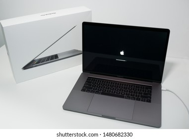 Porto, Portugal - August 3 2019: Apple MacBook Pro 15 inch notebook computer with touchbar. On a white desk with box.