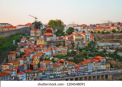 Porto, Portugal - August 31st 2018: View from the Dom Luis I Bridge with the popular Funicular. Funicular, which was built in 1891, is a local cable car joining Batalha and Ribeira in Porto city.