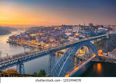 Porto, Portugal. Cityscape image of Porto, Portugal with the famous Luis Bridge and the Douro River during sunset.