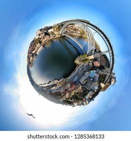 Porto, Portugal cityscape on the Douro River and Dom Luis I Bridge, tiny planet