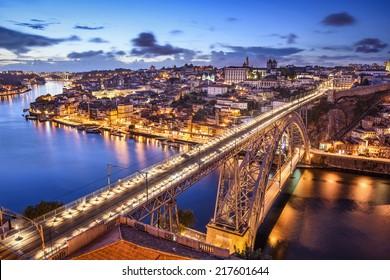 Porto, Portugal cityscape over the Douro River and Dom Louis Bridge.