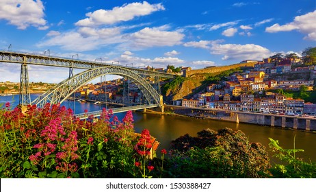 Porto, Portugal. Evening sunset picturesque view at old town with antique houses and red roofs near bridge Ponte de Dom Luis on river Douro. - Shutterstock ID 1530388427