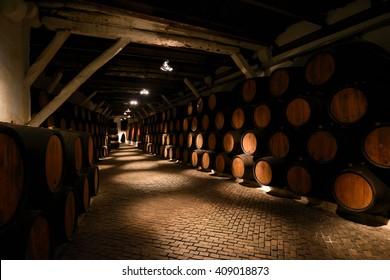 PORTO, PORTUGAL - FEBRUARY 11, 2016: Barrels of Porto vine in a cellar in Porto, Portugal