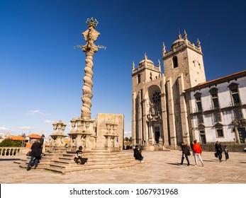 PORTO, PORTUGAL - FEBRUARY 12, 2018:  Porto Cathedral (Se do Porto) square  with Pillory (Pelourinho) column in historical center of Porto.
