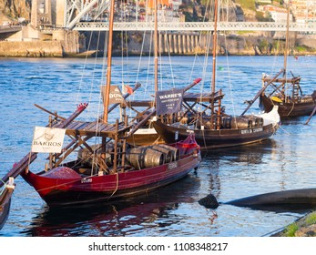 PORTO, PORTUGAL - FEBRUARY 18, 2018: Rabelo boats on the Douro river in the Old Town of Porto, Portugal.
