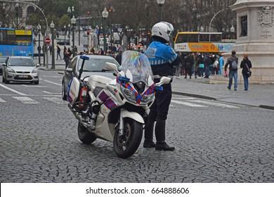Porto, Portugal - February, 26, 2017 - Policeman and his motorbike in Porto.