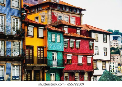 Porto, Portugal. Houses of Ribeira Square located in the historical center of Porto, Portugal along the river Duoro. It is included in UNESCO World Heritage List and is a favorite place for tourists